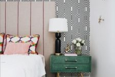 22 printed geometric wallpaper and a printed rug help creating a cool mid-century modern look