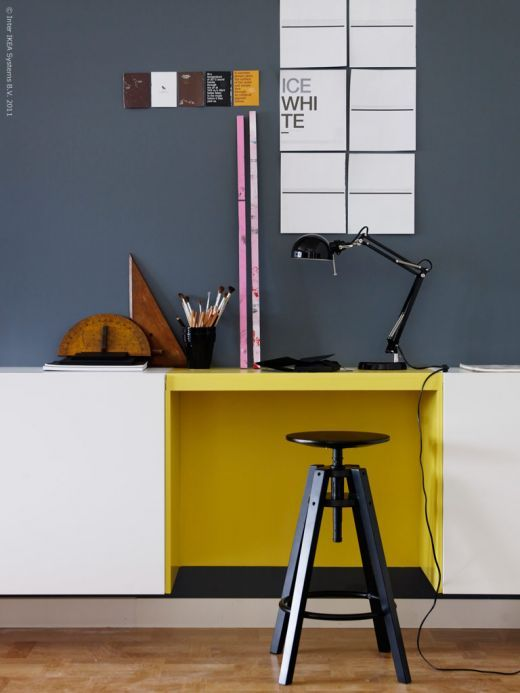 a creative way to rock color blocking at your home office with a graphite grey wall and a yellow touch on the desk