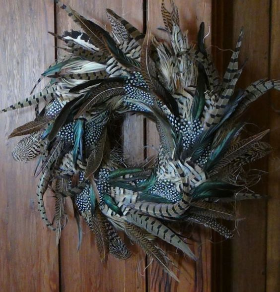 a lush feather wreath is great for Halloween decor and is sure to give a boho chic feel to the space