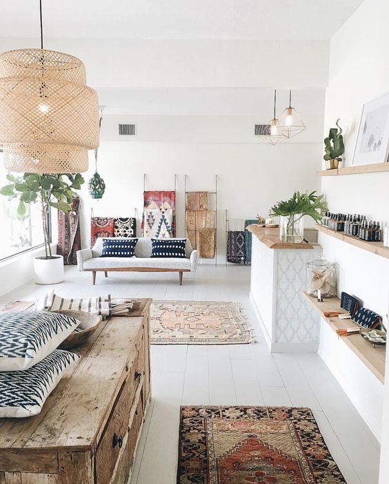 an open layout in Scandinavian style with various Nordic motifs and different boho chic prints