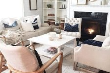 23 several different chairs and a sofa, a coffee table for a comfortable space