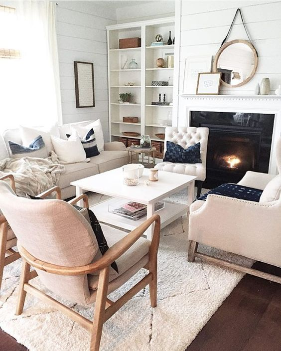 several different chairs and a sofa, a coffee table for a comfortable space