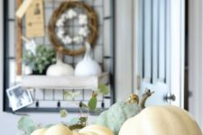 24 an all-natural fall or Thanksgiving centerpiece of a metal bowl, pumpkins, apples and greenery