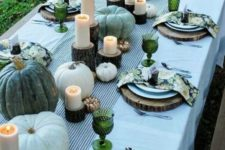 24 green heirloom pumpkins, green glasses and colorful floral print napkins dot the table with touches of color