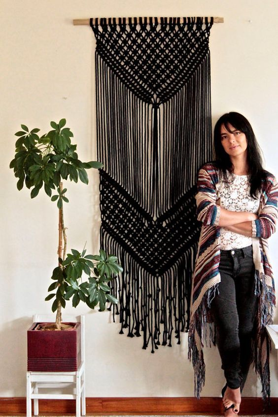 if you are good at macrame, you may create such a black hanging for statement Halloween decor