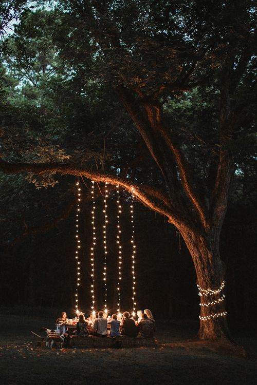 if you have a large tree around, use it for lighting, cover it with lights and hang them donw from the branches