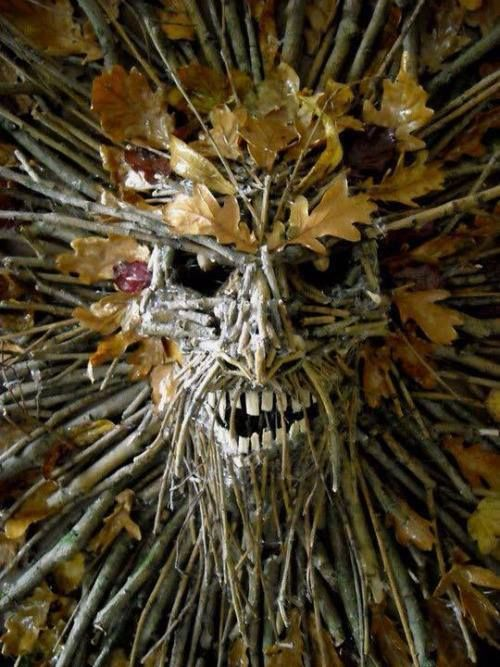 natural decor cna be spooky, just buy one plastic dollar store mask base, glue on branches and leaves