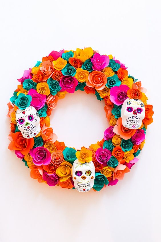 a super colorful paper flower wreath with painted sugar skulls is a chic idea that can be DIYed