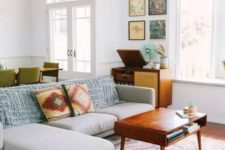 25 abstract pillows and a rug are great for sprucing up the space and making it mid-century modern
