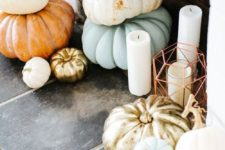 25 fill the non-working fireplace with heirloom pumpkins and place some candles in cool lanterns