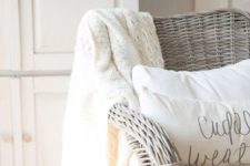 25 neutral decor with a wheat wreath, a creamy crochet blanket and creamy pillows for fall and Thanksgiving