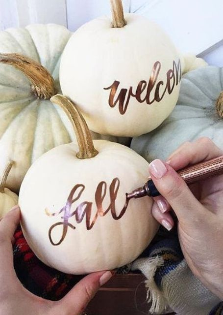 take usual or faux pumpkins and decorate them with a copper pen   so easy and so chic