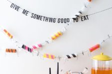 26 colorize your Halloween party with a colorful toilet paper roll and bright pumpkins