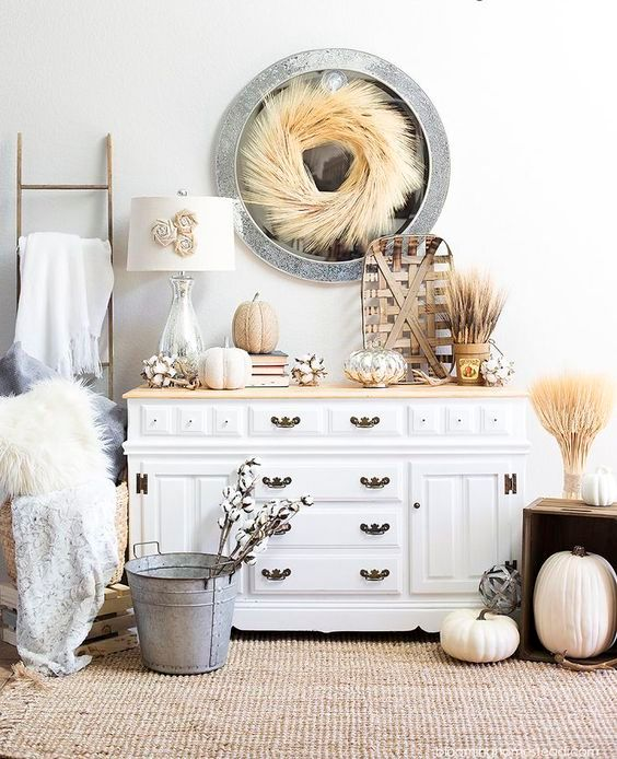 rustic fall or Thanksgiving console styling with wheat, pumpkins, cotton and faux fur for a chic look