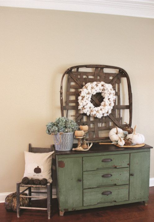simple and natural styling, with fabric pumpkins, a cotton wreath, potted greenery and antlers