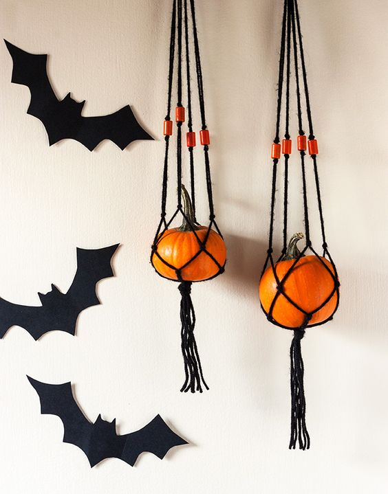 these fun hangers of blakc macrame and orange pumpkins are a simple and cute boho decoration for Halloween