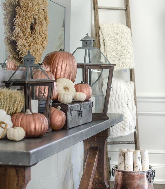 white and matte copper pumpkins are a great idea for simple Thanksgiving console or mantel decor