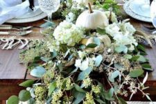 26 white real pumpkins, hydrangeas and fresh eucalyptus are all you need for a gorgeous Thanksgiving table decoration