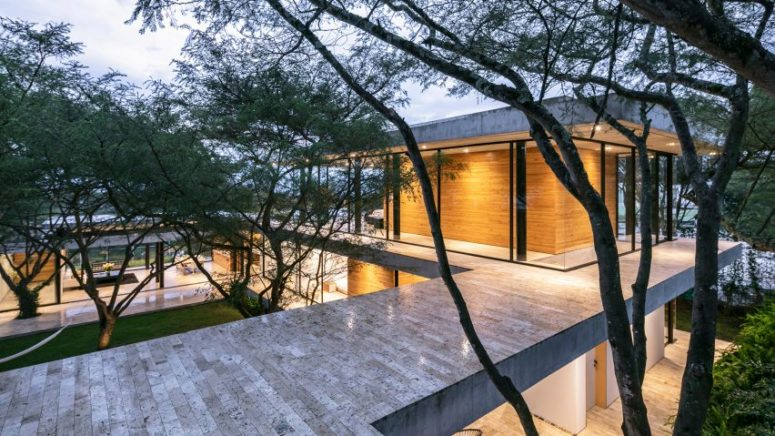 This contemporary house in Ecuador features three wings and trees growing through the house