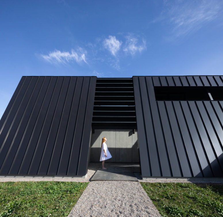 Minimalist Fortress-Like Home With A Black Exterior