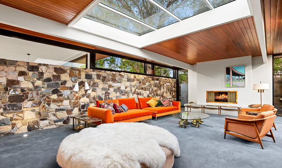 This gorgeous mid century modern home features contemporary aesthetics and some bold shades that aren't typical for mid century style
