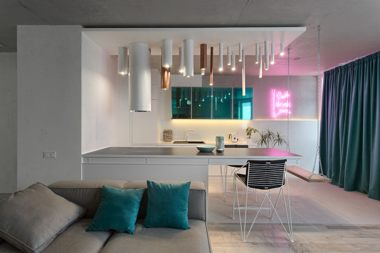 This minimalist apartment is spruced up with pink and green neon touches
