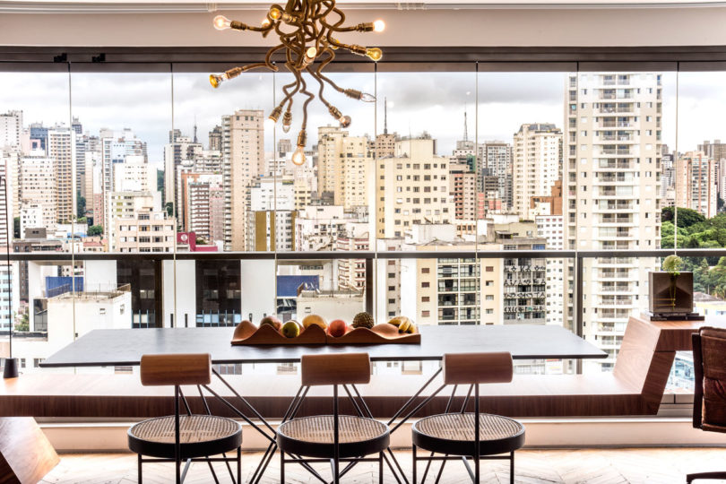 The dining space is located by a glazed wall to enjoy the views as much as possible