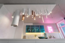 02 The kitchen is illuminated with tube-like lamps and a pink neon light