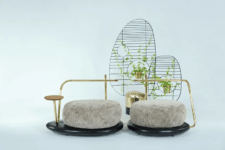 The sofa is composed of two parts with a side table and even some space for flower pots