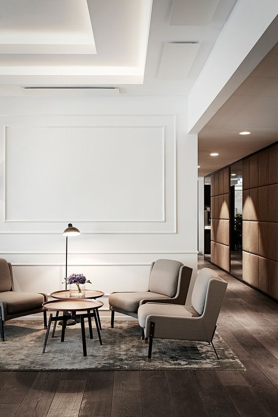 a contemporary sitting space with shapely furniture and wall panels for a chic touch and refined feel