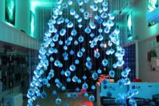 02 a large and beautiful ice blue suspended Christmas tree of ornaments floating above the floor