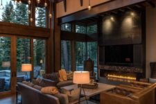 02 a modern rustic luxurious home with a double height ceiling and a whole hanging light installation