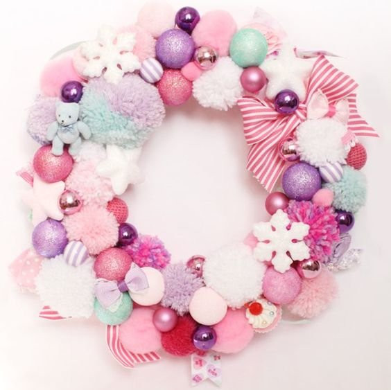 a sweet pastel Christmas wreath of pompoms, ornaments, bows and snowflakes of soft shades