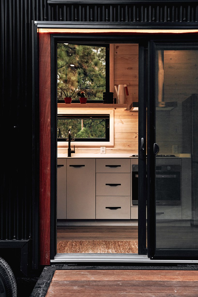 The doors are glass sliding ones to save the space and enjoy the views even when the doors are closed