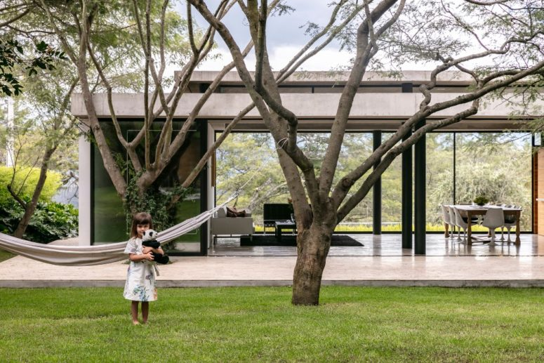 The house can be opened to outdoors anytime, there are sliding doors and glazed walls