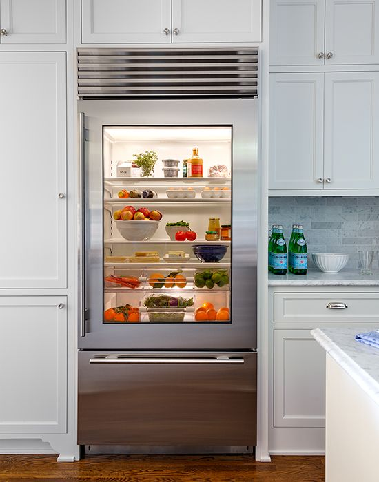 a glass door fridge is a cool idea for a contemporary space, though it needs more maintenance, it instantly adds a modern feel