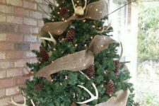 03 a rustic feel is brought with burlap ribbons, pinecones, antlers and lights is a cozy outdoor decoration