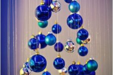 03 a small Christmas tree of matte and shiny blue ornaments and little silver ones is a whimsy and creative DIY idea