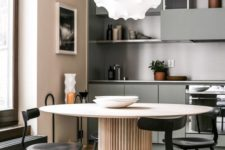 03 a soft pastel minimalist kitchen in blush, beige and with touches of muted green plus black chairs