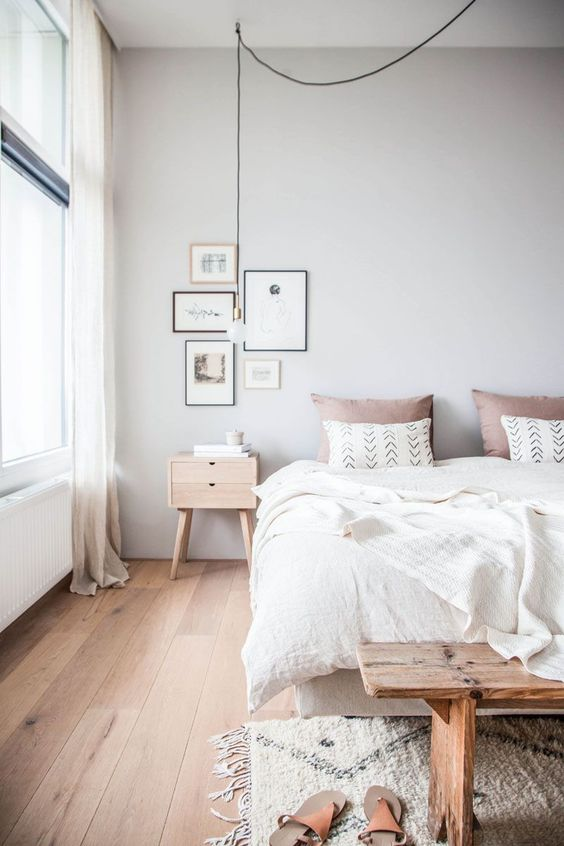 a welcoming and airy Scandinavian bedroom with all-natural linens and a touch of dusty pink