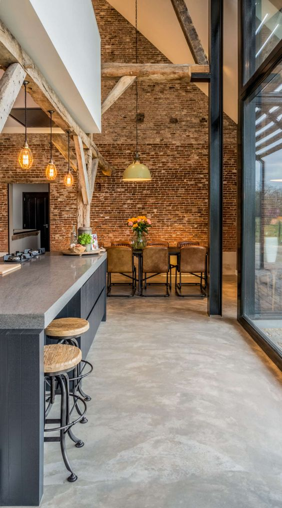 an industrial home done in greys, browns, off-whites and lots of brickwork and wood