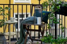 03 pillows, rugs and a knit blanket, potted greenery, a small table for a cozy little winter balcony