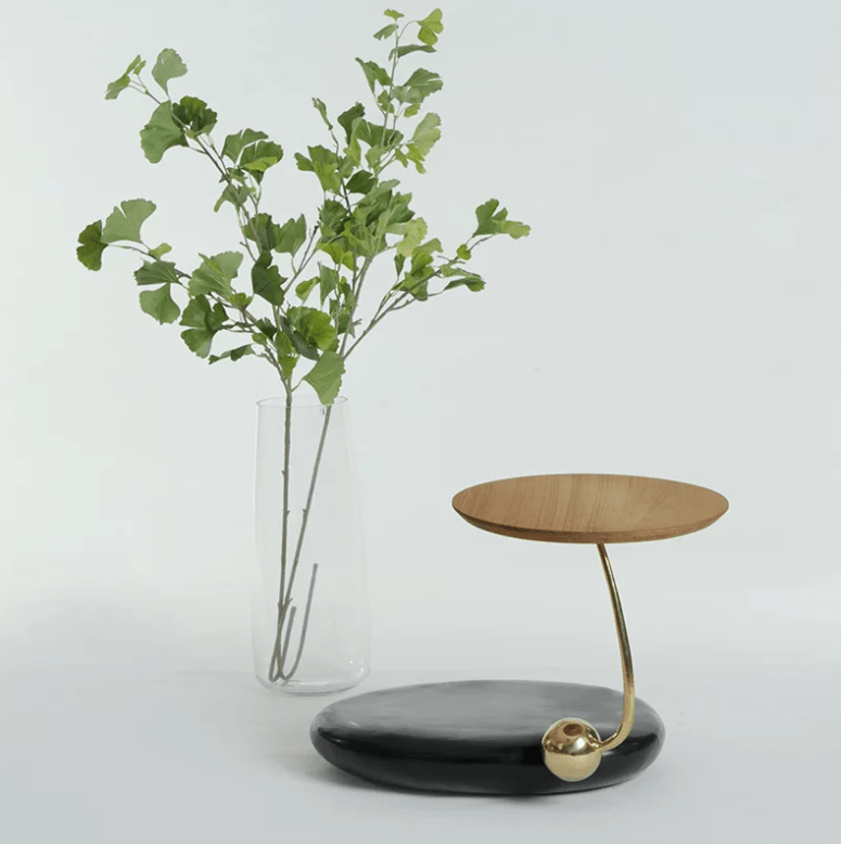 This chic table is also included in the collection, it's composed of stone and wood