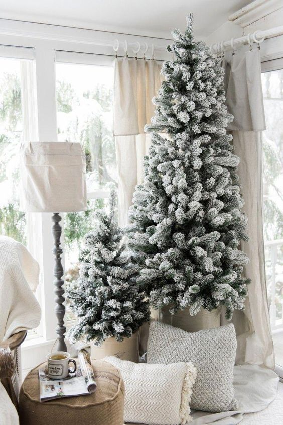 a duo of snowy Christmas trees with no decor is a great idea for a farmhouse, Scandinavian or contemporary space