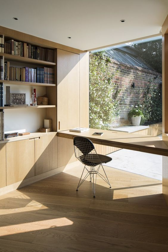 a glazed wall with a built in shelf like desk, you may hide it and enjoy the view completely