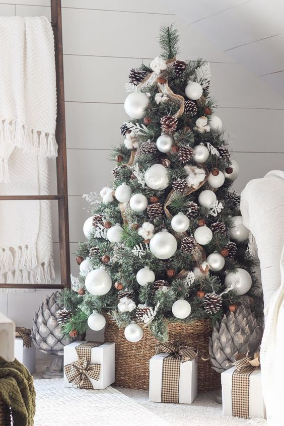 a rustic Christmas tree with pearly ornaments, snowflakes, snowy pinecones, burlap and cotton flowers