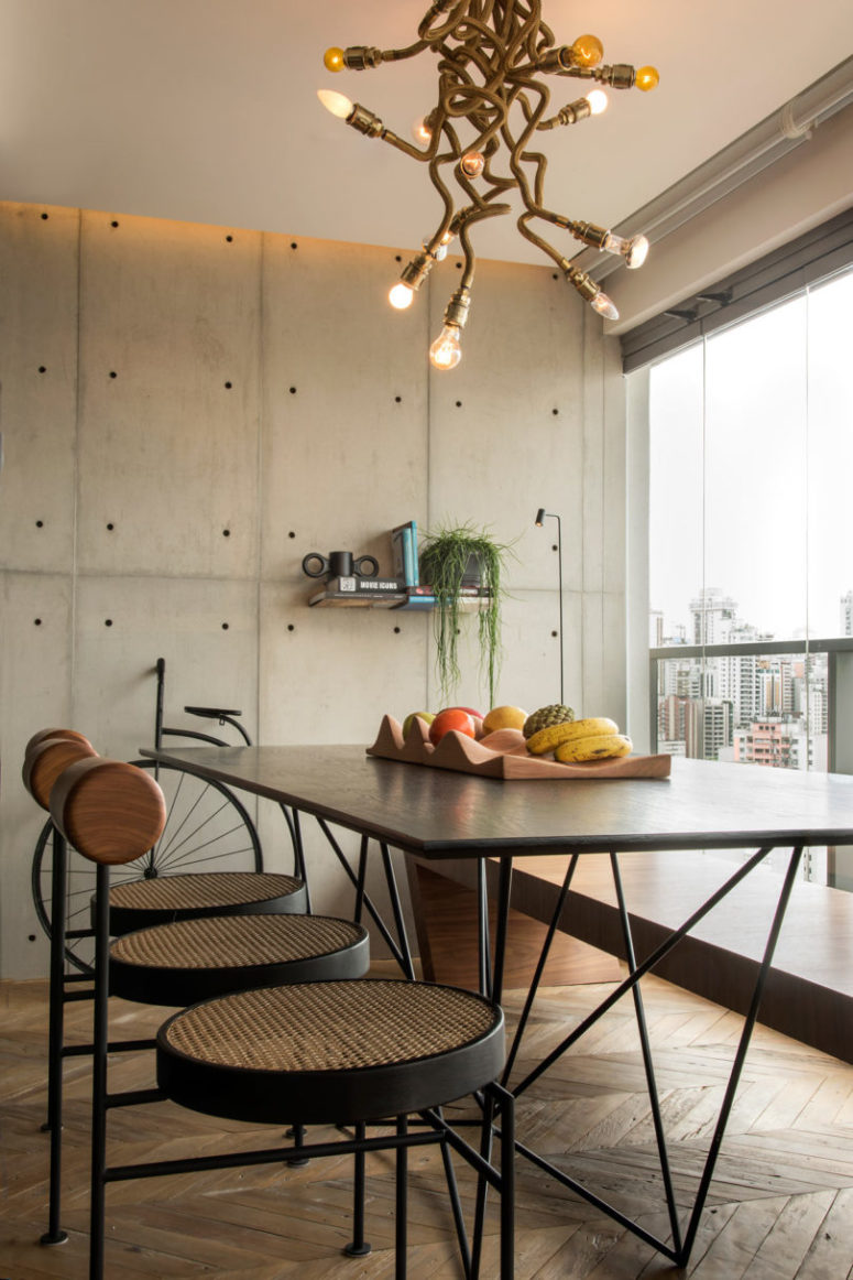 Concrete and metal decor brings an industrial feel