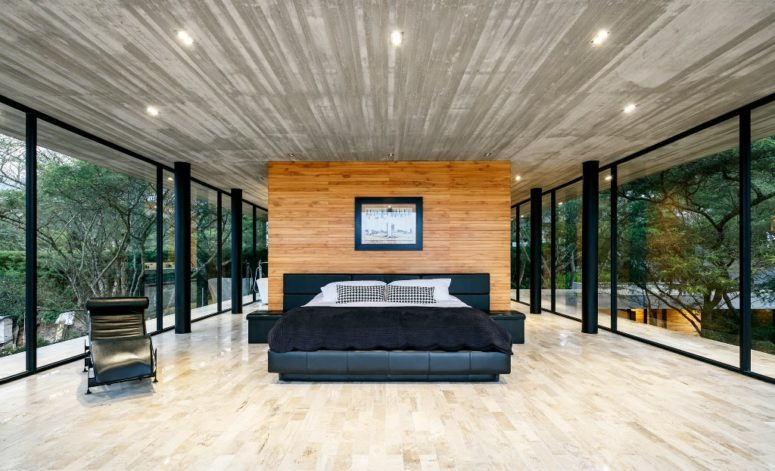 The master bedroom is glazed from all sides to make the owners feel like outdoors