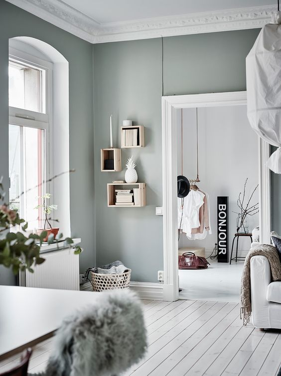 a Scandinavian space spruced up with pale green looks unusual and very catchy