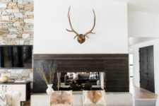 05 a modern rustic space with jute, fur, wood and stone in decor plus cowhide chairs